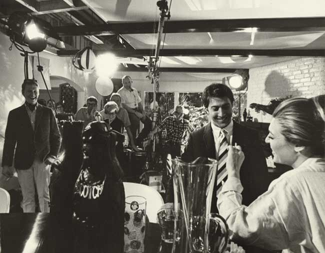 Director Mike Nichols, Dustin Hoffman and Anne Bancroft with crew on the set of The Graduate, 1967.