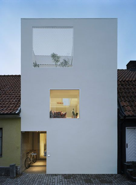 This narrow house was built in a street of traditional terraced cottages in Landskrona, Sweden.