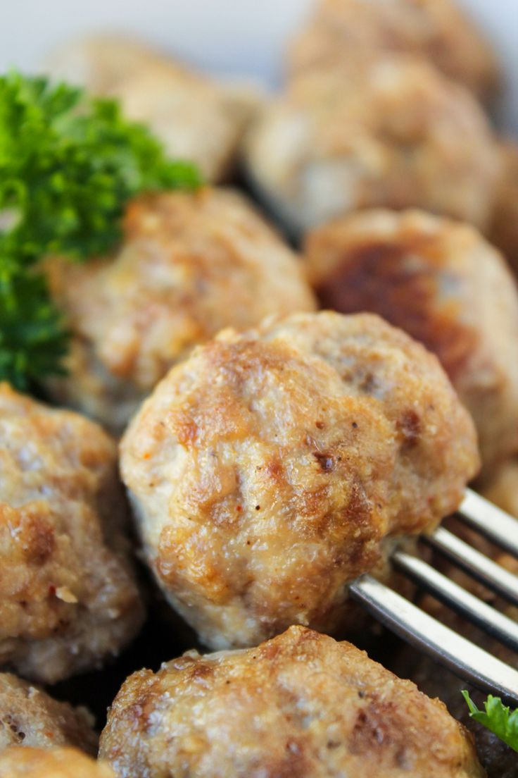 Easy Baked Meatballs from TheFoodCharlatan.com.  My changes from Rachael Ray's meatball recipe:  I use ground turkey mixed with a little ground beef to equal about 2 pounds of meat.  I use garlic-cheese croutons instead of bread crumbs, and soak them in milk, then ring them out before mixing the rest with my hands.  I use one egg, not 2.