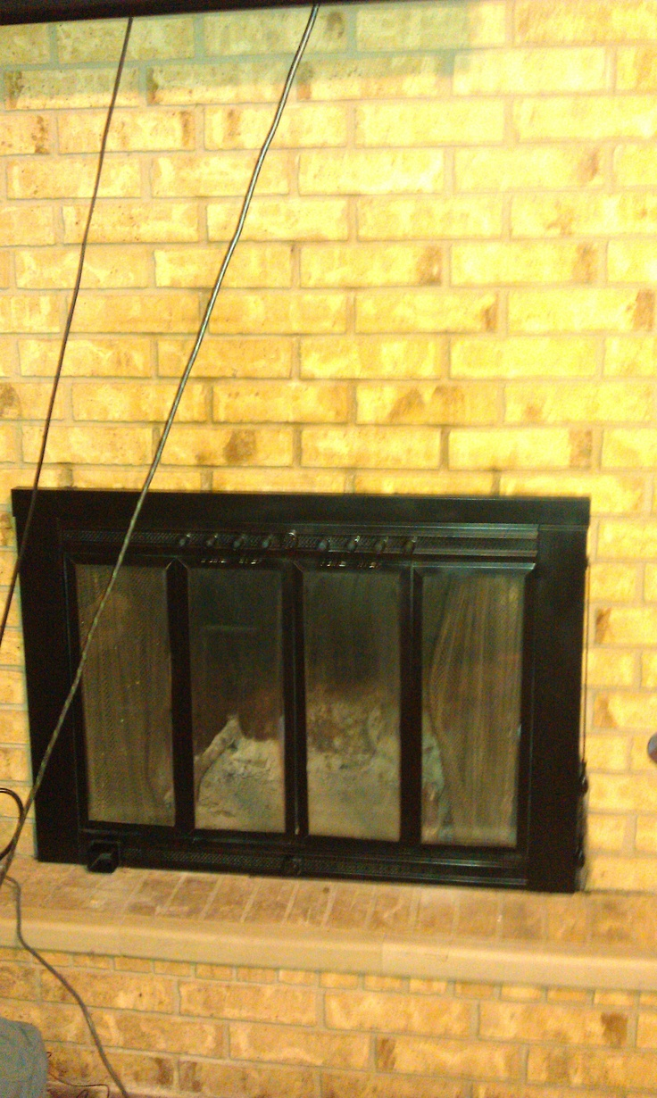 My fireplace AFTER I updated. It makes a huge difference in the room! All I did was prime and then spray paint it with heat resistant spray paint (like those used on your outdoor cookers)