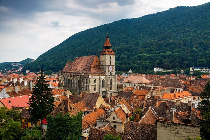 The Black Church towering over the medieval, old town area of Brasov, Romania.