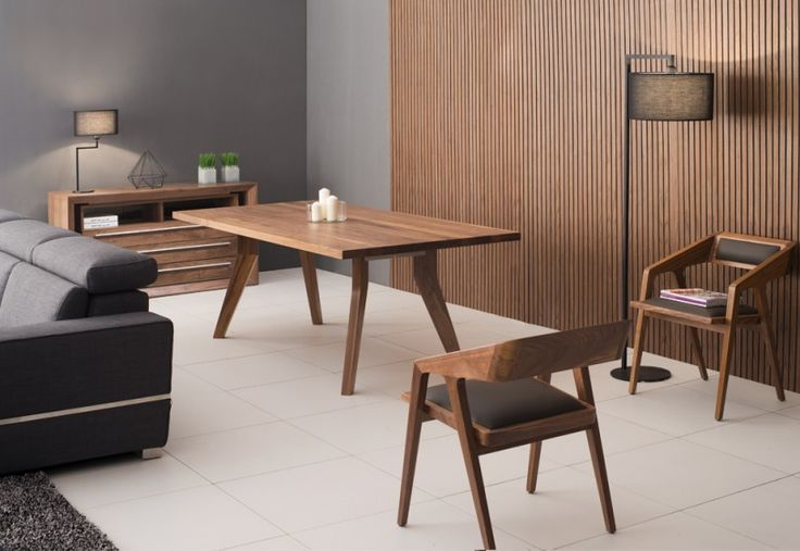 Colorado Walnut Timber Dining Table  Nothing is compromised or exaggerated with our sleek, sophisticated solid timber dining table. Timber furniture adds a warm, natural sophistication to the starkness of modern, minimalist design with functionality in mind. Our solid timber is responsibly sourced from American walnut trees and expertly finished with a unique wax oil that brings out the natural colors and grains while protecting the wood from daily use.