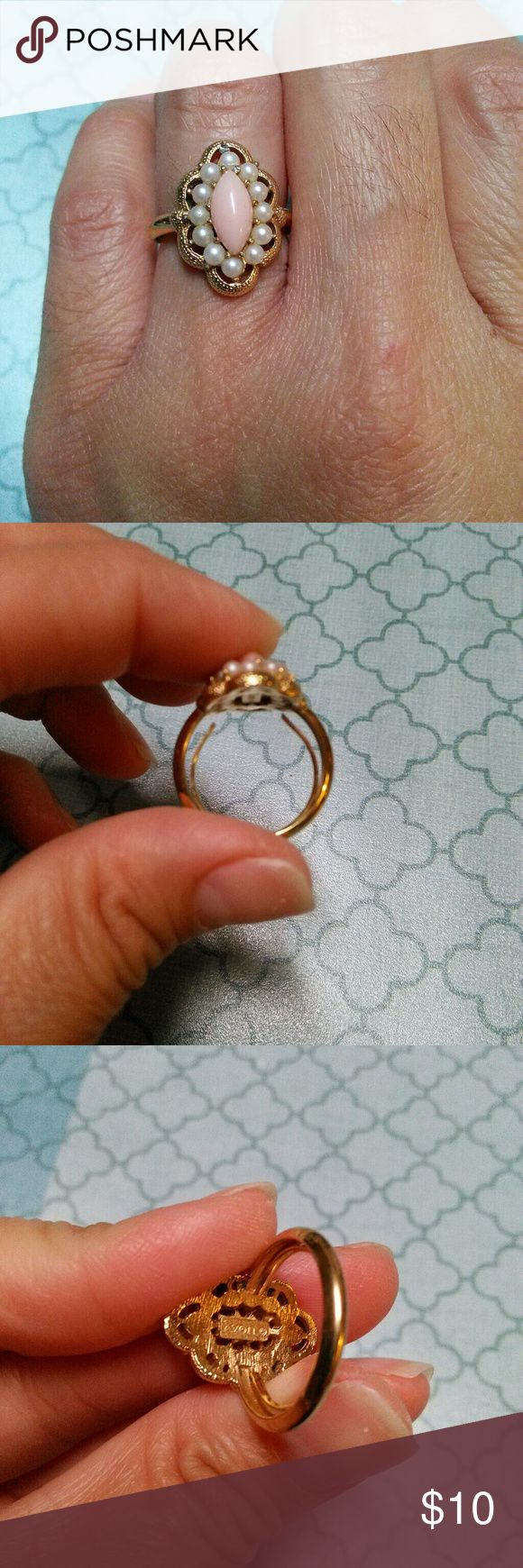 Vintage AVON RING Cute dainty ring with an in adjustable size adjuster in the center as shown...Can fit a smaller size or 7 Jewelry Rings