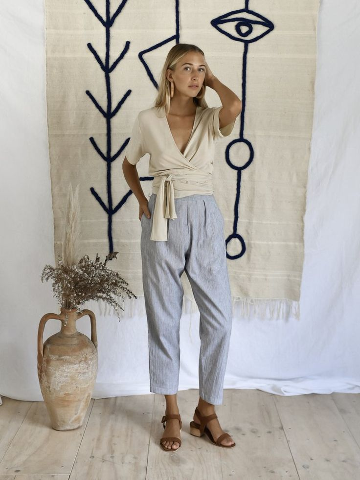 FINNÉN TROUSER |STRIPE Peg leg trouser ankle lengthin blue thin stripe (cotton) Alsoavailable in Dried herb (cashmere cotton blend) We recommend going down a size, this style has a large fit Cool machine wash. line dry. cool iron. do not bleach. please use environmentally friendly detergents