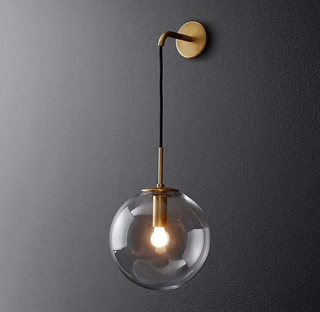 RH's Languedoc Sconce:The character of 1960s French lighting is captured in this sconce from renowned designer Jonathan Browning. With glass globes suspended from a slender brass frame, the fixture has the appearance of floating in space.