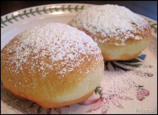In my native Serbia, the tradition on New Years Day is to eat krofne.  Krofne are sweet and airy doughnuts that are made with a yeast-activated dough similar to beignets. Always round in shape, krofne symbolize that we have come full circle and are about to start anew!