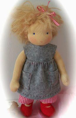 Poppenatelier Ineke Gray / She is wearing a felted by hand dress, underwear