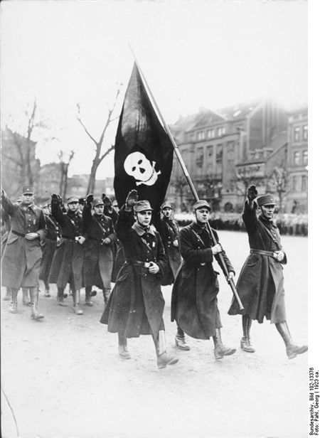 The SA Death's Head Brigade [Die Totenkopf-Brigade] during a March in Braunschweig (c. 1923)