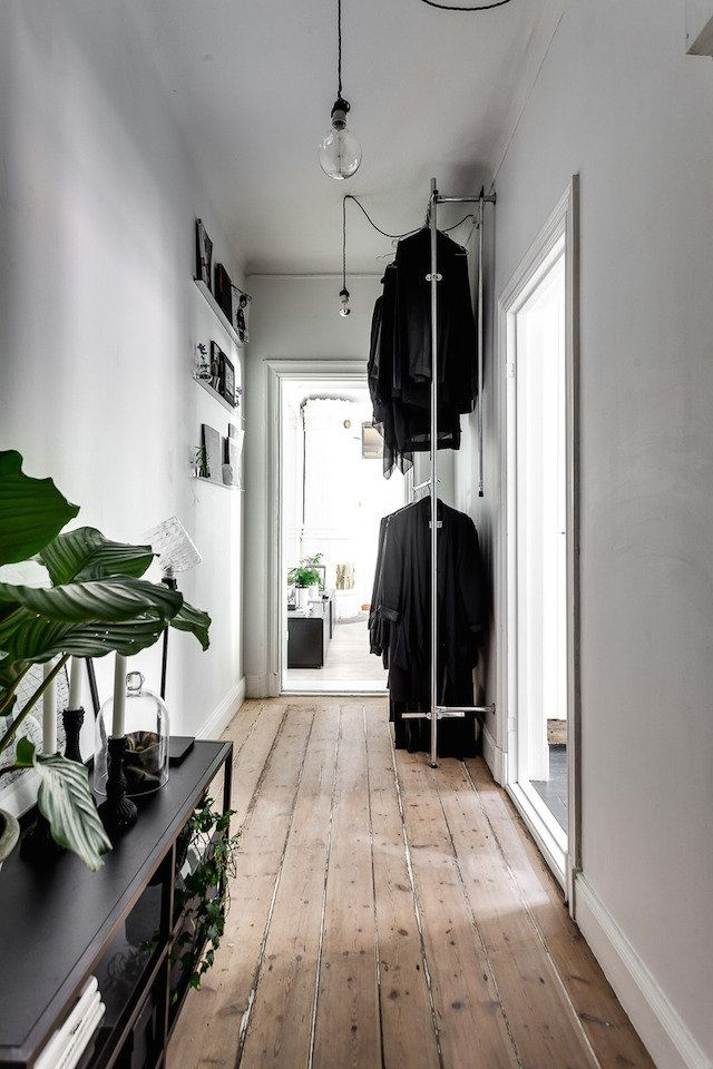 Open storage / clothes rail and beautiful wood floor in the hallway of a Stockholm apartment.