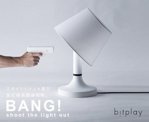 Bitplay's Bang! lamp Lets You Shoot The Light Out that lets you turn it on and off through a remote control that's shaped like a gun. Pull the trigger, the light goes out and the lampshade actually tilts as if shot.