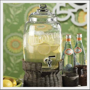 Lemonade Dispenser. Dispense fun, flair and drinks with our glass Lemonade Dispenser. Clear glass with removeable lid for easy fill and cleaning. Stainless steel spigot with lever handle for easy dispensing. Elevated within the chocolate rattan base.