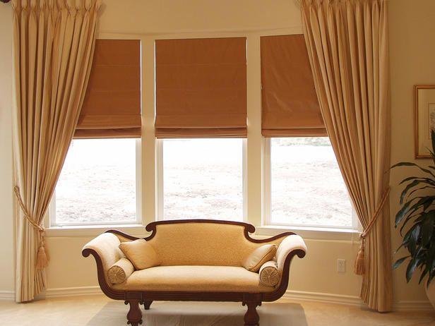 Window Treatment ideas for Bay Windows | antique settee in bay window