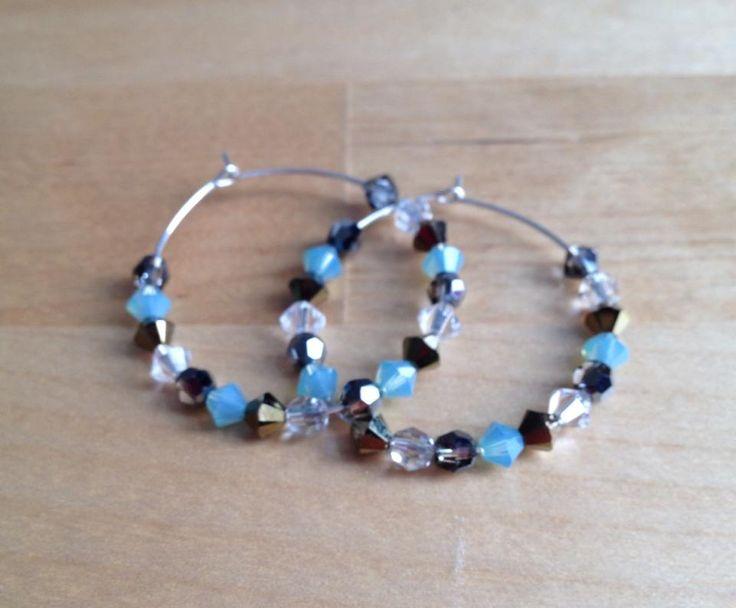 Halo Swarovski Crystal Hoop Earrings (MGE68) $28.00 A colourful combination of sparkling crystals on sterling silver hoops. Hoops measure 34mm in diameter.