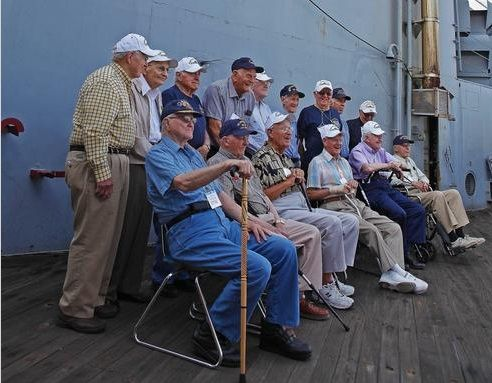 The surviving members of the USS Massachusetts pose for photos at their 68th reunion on board the ship   - http://www.warhistoryonline.com/war-articles/the-surviving-members-of-the-uss-massachusetts-pose-for-photos-at-their-68th-reunion-on-board-the-ship.html