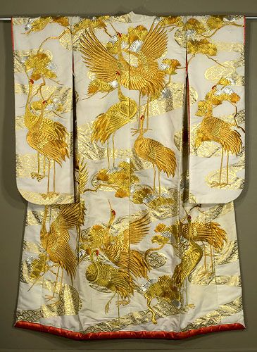 Japanese Uchikake 1930s. Silk faille wedding kimono with gold and silver embroidery and gold surihaku—stenciled gold foil. The cranes depicted here symbolized long life.