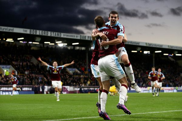 Ashley Barnes of Burnley (C) celebrates scoring his sides third goal with Jon Flanagan of Burnley (R) during the Premier League match between Burnley and Crystal Palace at Turf Moor on November 5, 2016 in Burnley, England.