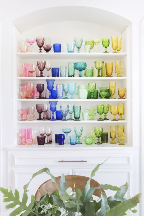 "Blogger Elsie Larson, of the lifestyle blog abeautifulmess.com, says that the rainbow effect of her colored depression glass collection ""makes me smile every morning."""