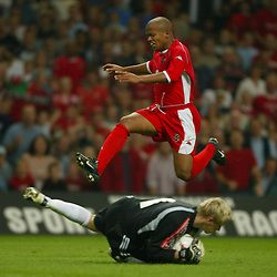 Finland's goalkeeper Antti Niemi makes a save at the feet of Wales' Robert Earnshaw during the Euro 2004 qualifying match at the Millennium Stadium. (Pic by David Rawcliffe/Propaganda)