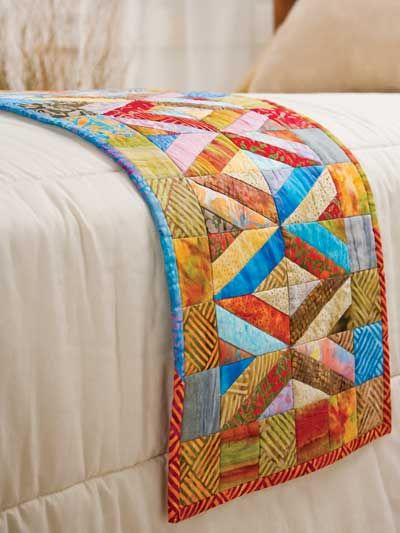 Pattern sold as a bed runner, however I'm making it as a table runner in Christmas prints. Great gift idea.