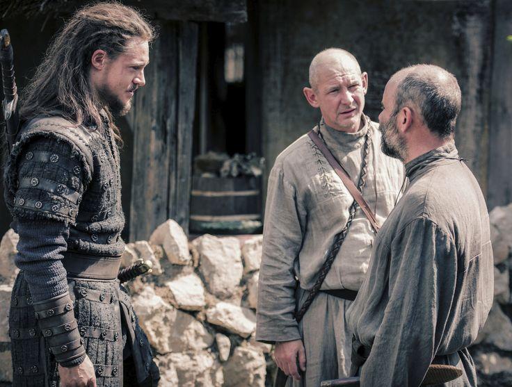 "Alexander Dreymon as Uhtred of Bebbanburg (with Ian Hart as Father Beocca and Cavan Clerkin as  Pyrlig) in ""The Last Kingdom"" Season 2 From http://www.farfarawaysite.com/section/lastkingdom/gallery2/gallery5/gallery.htm"