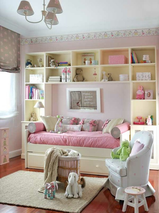 Love the soft colors and the shelving around bed. When the child gets older, you could switch to brighter colors and make the shelves the head board for a bigger bed coming straight out. Or make it into a desk/vanity area.