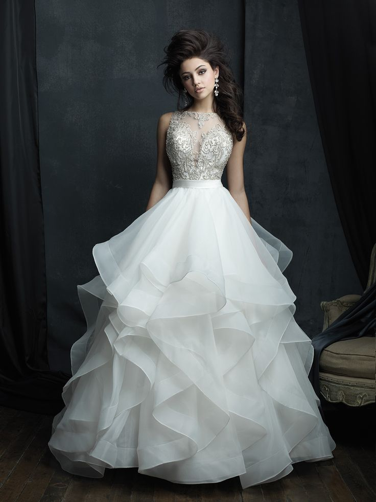 Decadent ruffles and crystal beadwork adorn this striking ballgown // Allure Couture C380