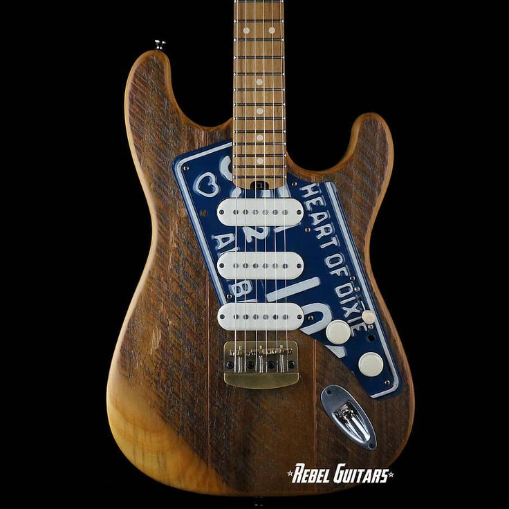 Here is a new Dismal Ax Road Dog with a 1963 Alabama licensed plate on a Salvaged Pine body, Maple neck, Black Locust fretboard, Hipshot tuners, brass hardtail, and Dismal Homespun single-coils. Plays and sounds great. Comes with COA and hardshell case. Rebel Guitars is an authorized Dismal Ax de...