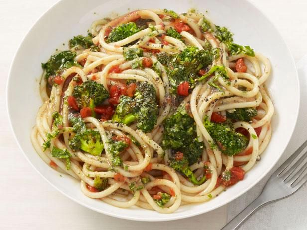 Pasta with Roasted Broccoli and Almond-Tomato Sauce: Change things up for pasta night with this hearty dish made with roasted broccoli and pesto-inspired sauce using almonds and basil.