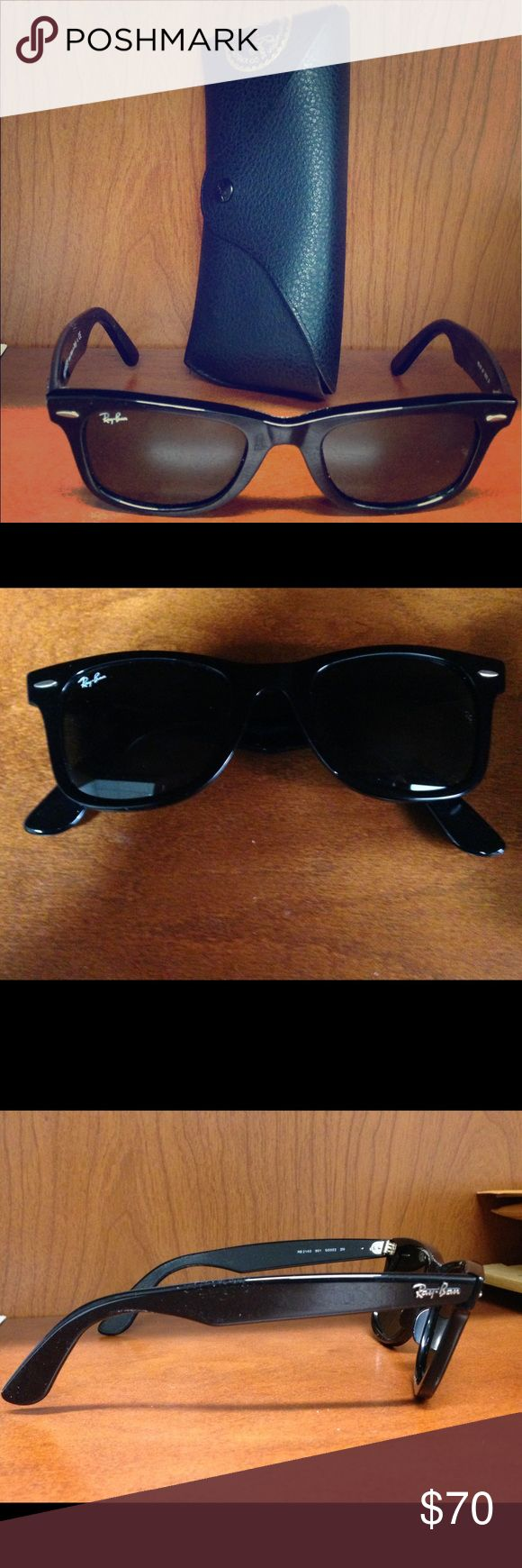 Ray Ban Wayfarer sunglasses Classic black retro Ray Ban Wayfarer sunglasses, NWOT, comes with case, cleaning cloth, and original promotional booklets. Ray-Ban Accessories Sunglasses