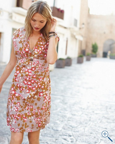 A covetable above-knee-length dress in a choice of pure cotton voile or eyelet is always unforgettable. We've made it even more alluring with a low neckline and elongating empire waist.