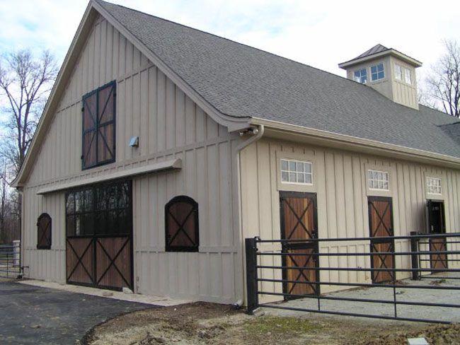 dark doors on light colored barn