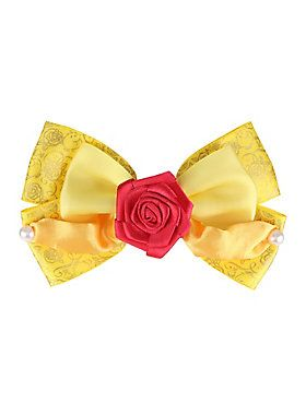 "<p>Hair bow from Disney's <i>Beauty And The Beast</i> with a design inspired by Belle's yellow dress.</p>  <ul> 	<li>4 1/2"" across</li> 	<li>Imported</li> </ul>"