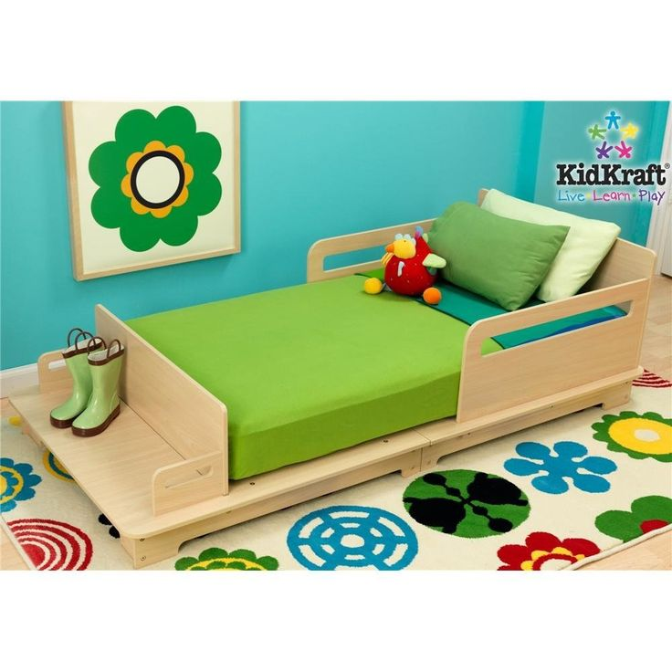 kidkraft Modern Wooden Toddler Bed. Very low to ground. Built-in bed rails for added protection. Like the bench at the end.