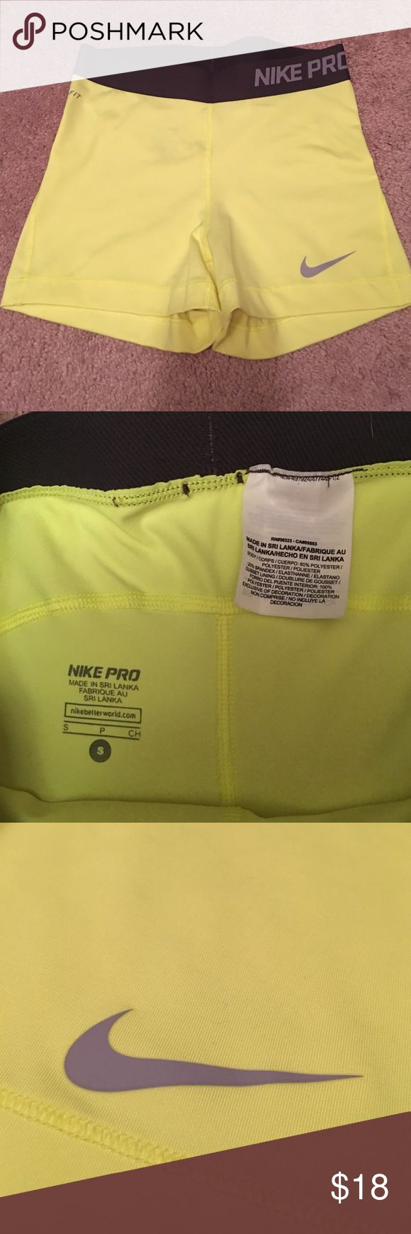Neon yellow Nike Pro Spandex Nike Pro Dri-Fit shorts. Color is a bright neon yellow with dark grey band around the waist. Maybe worn once, so they are in great condition! Selling due to them sitting in my closet for so long. Nike Shorts
