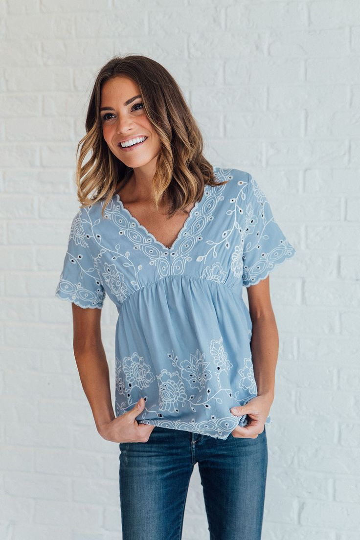 DETAILS: - Blue Empire Waist top, with eyelet detail - Beautiful flutter sleeves - Model is wearing size S - Bust: S= 34 in, M= 36 in, L= 39 in - Waist: S= 42 in, M= 43 in, L= 44 in - Length: S= 22 in