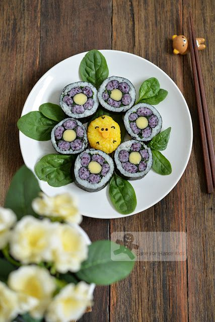 Purple flower sushi plus one special Kiiroitori rice ball for my son