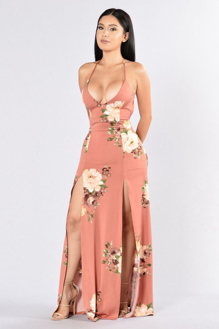 Available in Salmon Floral and Black Maxi Dress 2 Front Slits Spaghetti Straps X Back Detail V Neckline Made in USA 96% Polyester 4% Spandex
