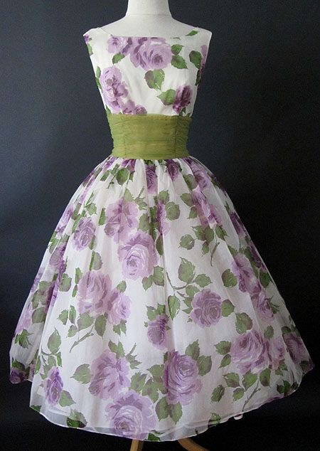 wonderful 1950's chiffon party cocktail dress with large purple and lavender roses. The chiffon lies over white satin and a built in crinoline.