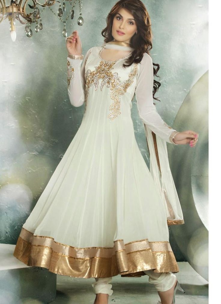 Be Your Distinct Trend Diva With This Cream Net Ready Made Salwar Kameez. You Could See Some Intriguing Patterns Done With Gold Zardosi,Lace,Patch Work,Silver Zardosi Work.