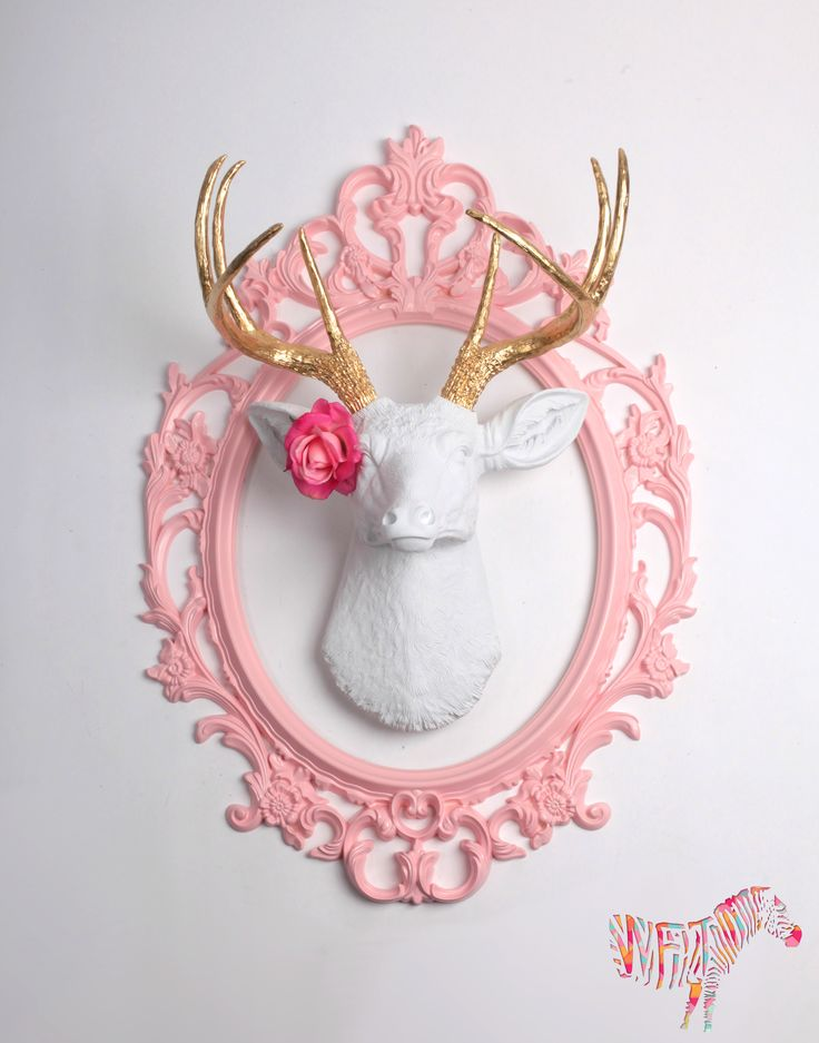 The Alfred white faux deer head wall mount with gold antlers. Faux stag animal head decor and wall decor by White Faux Taxidermy. Similar to Sherwin Williams email.  We love the way that one of our clients @Danna Profitt has used The Alfred with our pink actual touch rose accessory in this room! He looks just lovely!