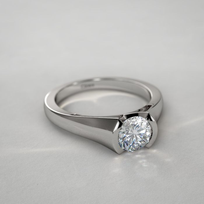 Unique Half Bezel Set Diamond Ring in 14k White Gold... Look at settings on this site.