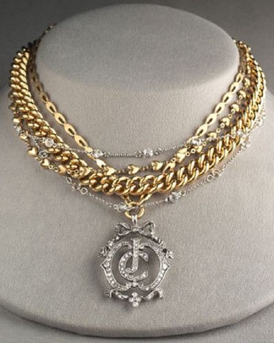 Juicy Couture Multi-Strand Crest Necklace $159.99. This Gorgeous layered necklace from Juicy Couture is just stunning.  Five lovely strands of gold and silver chains in alternating styles, lengths, colors and textures join together to form this lovely piece.