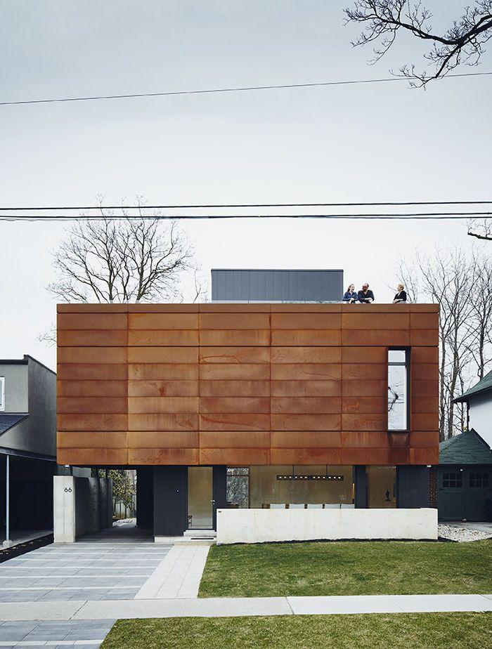 A boxy, Cor-Ten steel front facade
