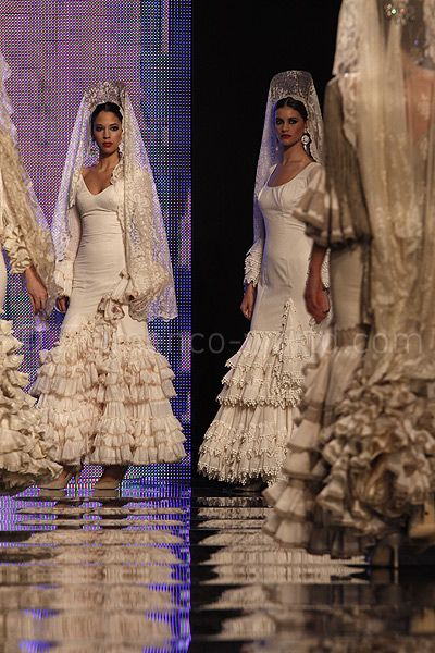 If I got married again I would do a winter wedding with this dress minus the mantilla... LOVE