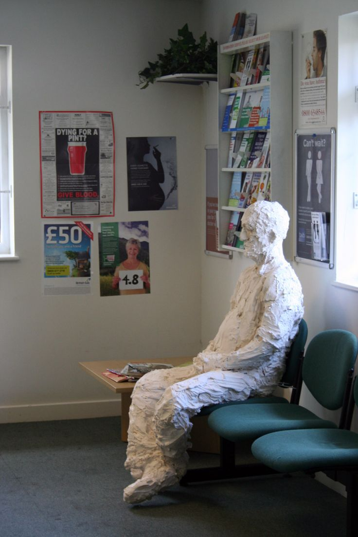 Waiting: life-size plaster sculpture in a doctors' waiting room.