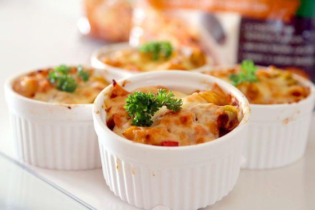 Mini pasta bakes is a good idea. This one is ham, mushroom, (prawn?), cheese