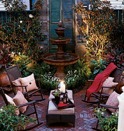 Despite the fact that we have 2.25 acres, I think this would be a wonderful idea to create a small courtyard behind the house.