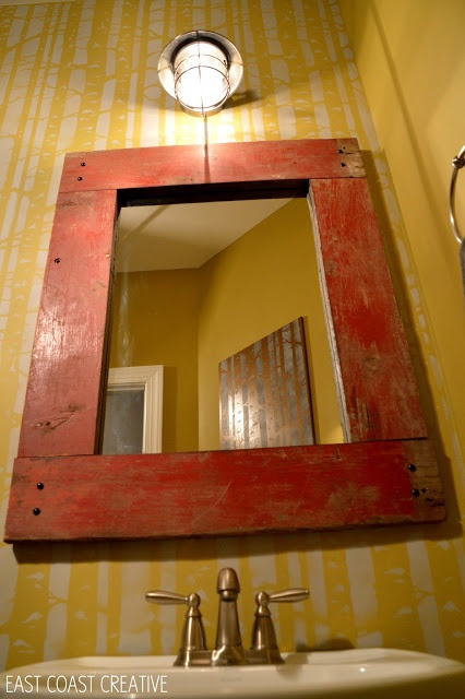 How to Make a Wood Framed Mirror - use liquid nails to attach wood to the mirror