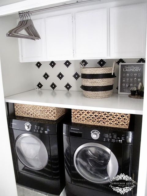 Use decals to create a backsplash pattern above your machines // laundry room