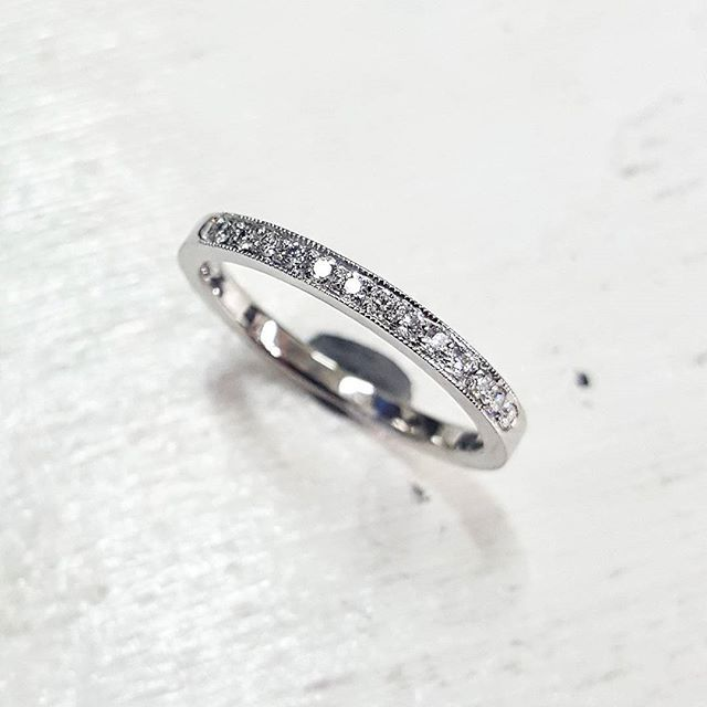 Custom made platinum & diamond ring. Grain set with millgrain detailing on the edge of the ring. I love the detail that millgrain offers!